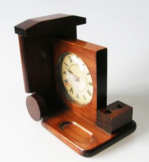 schöne alte Buchstütze aus Massivholz mit Uhr und Stiftehalter