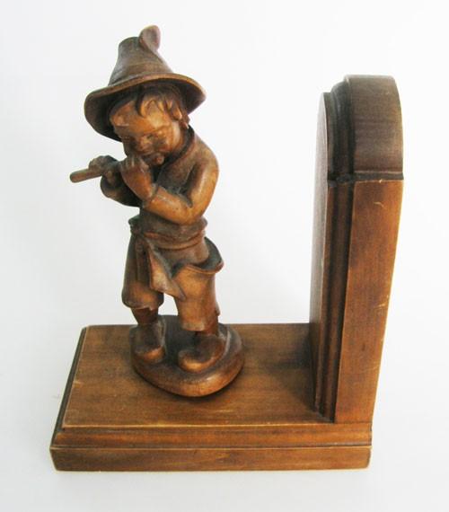 antike Buchstütze aus Holz der Flötenspieler 20x17 cm